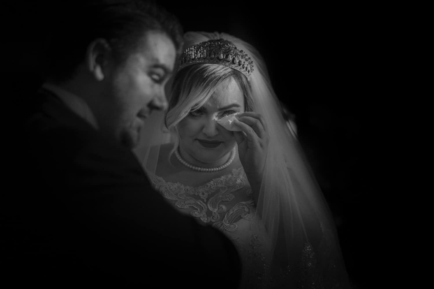 bride mipes her tears