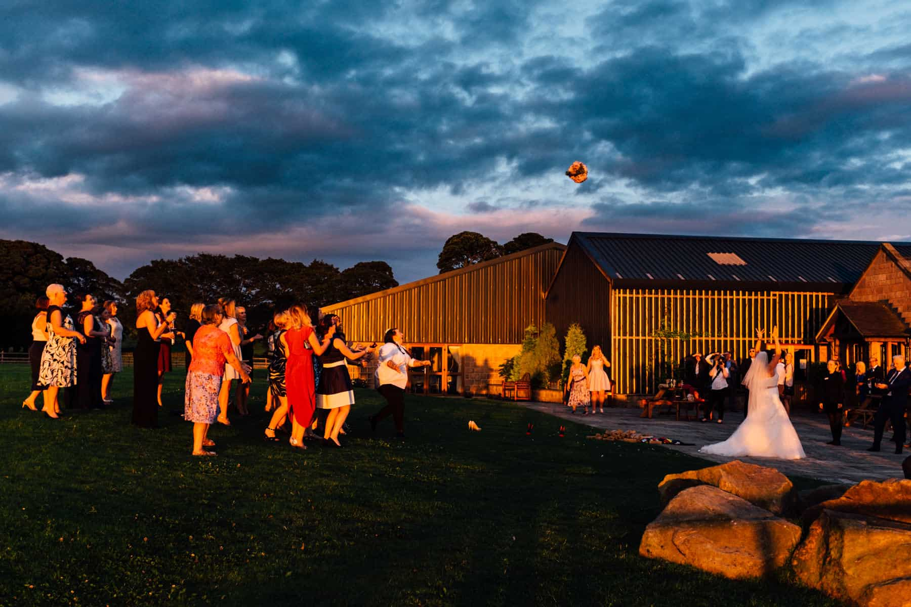 wedding photography bride in sunset bouquet toss (1 of 1)