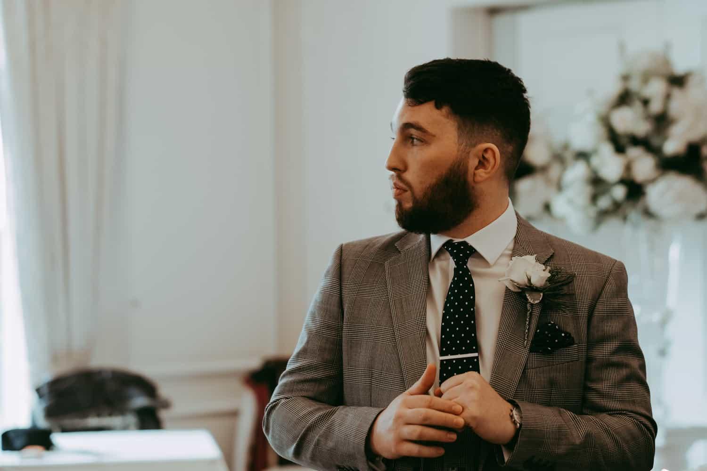 a nervoiuse groom