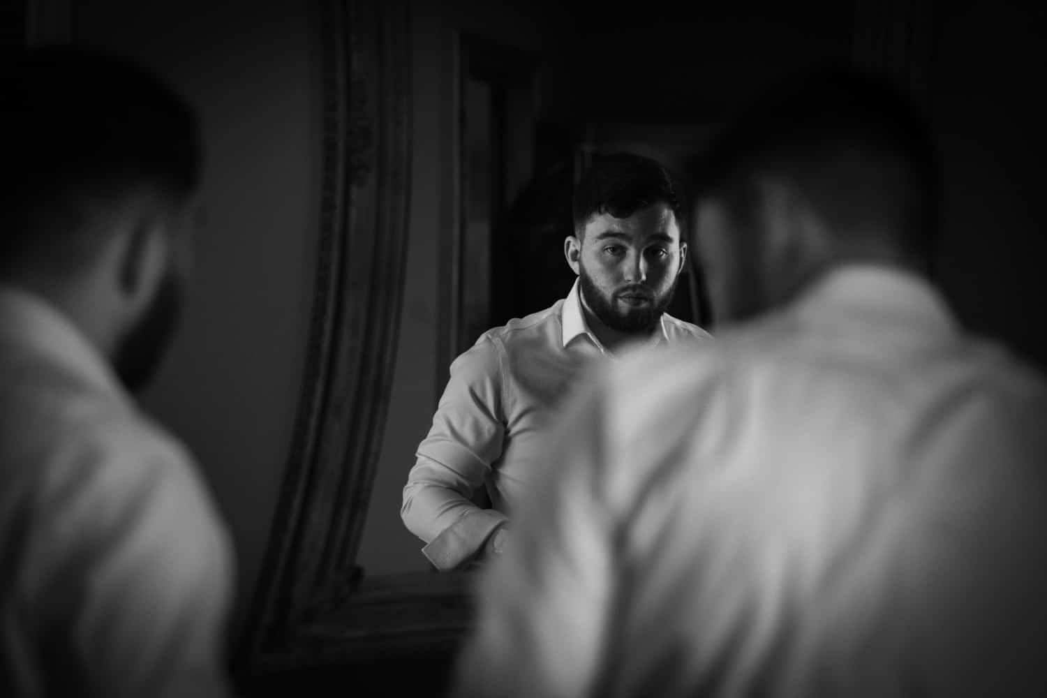 groom portrait in the mirror