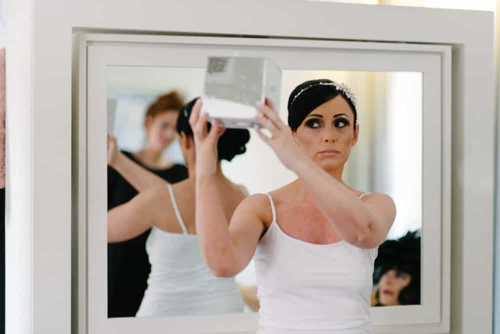 bride checks her hair