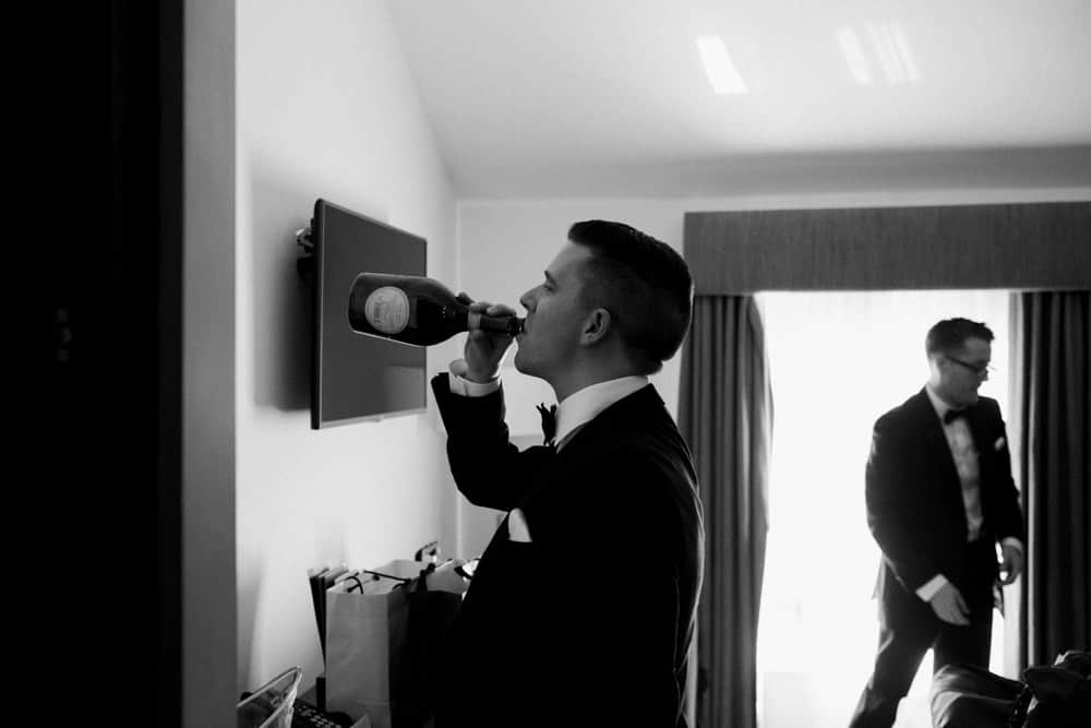 groom enjoying the champers!