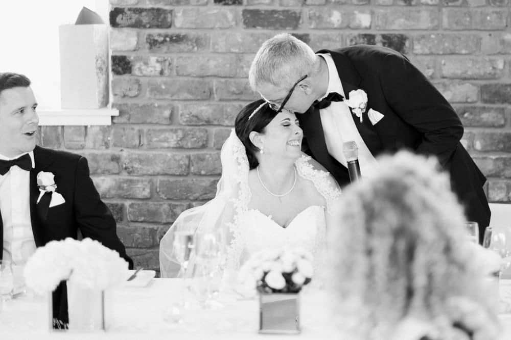 bride's dad kisses her head