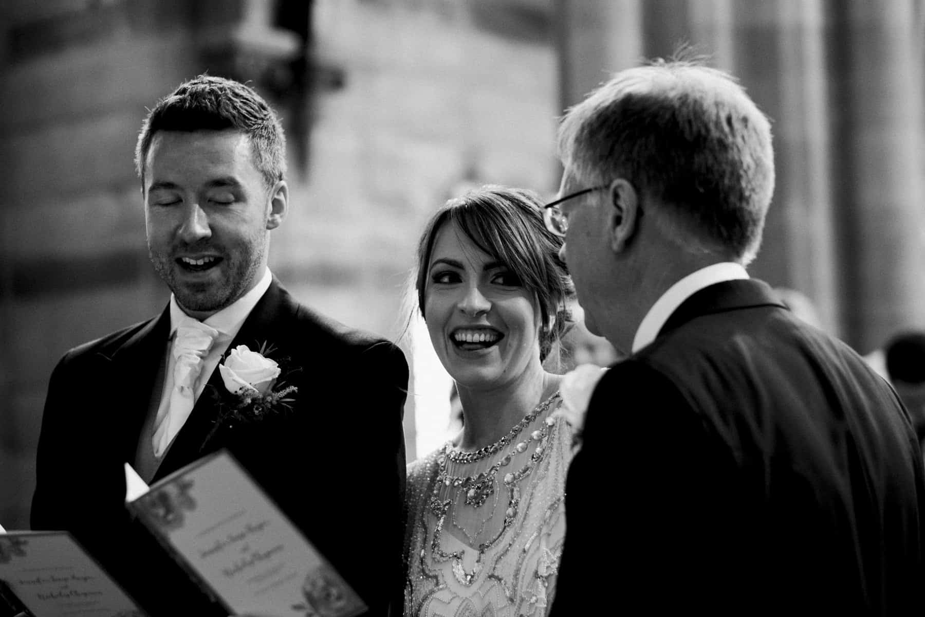 bride and her dad share a joke