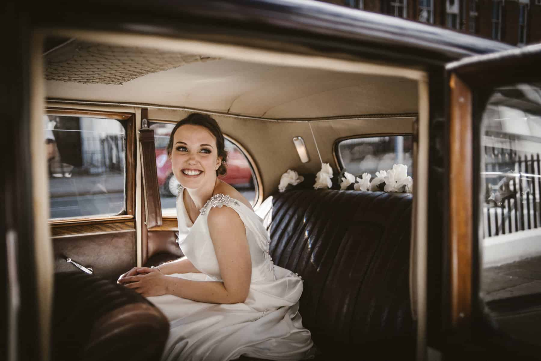 excited bride in the wedding car