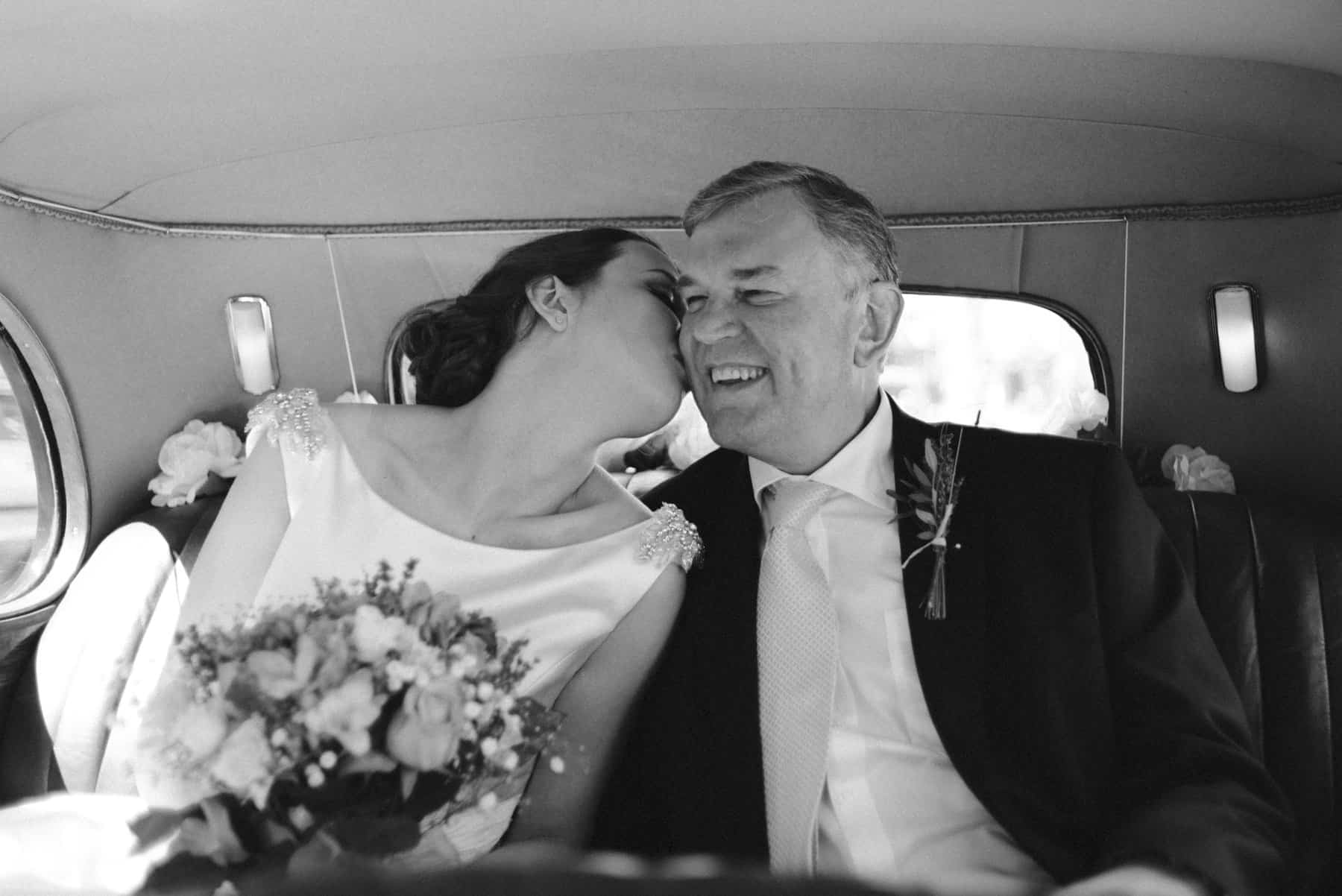 bride and her dad share a moment