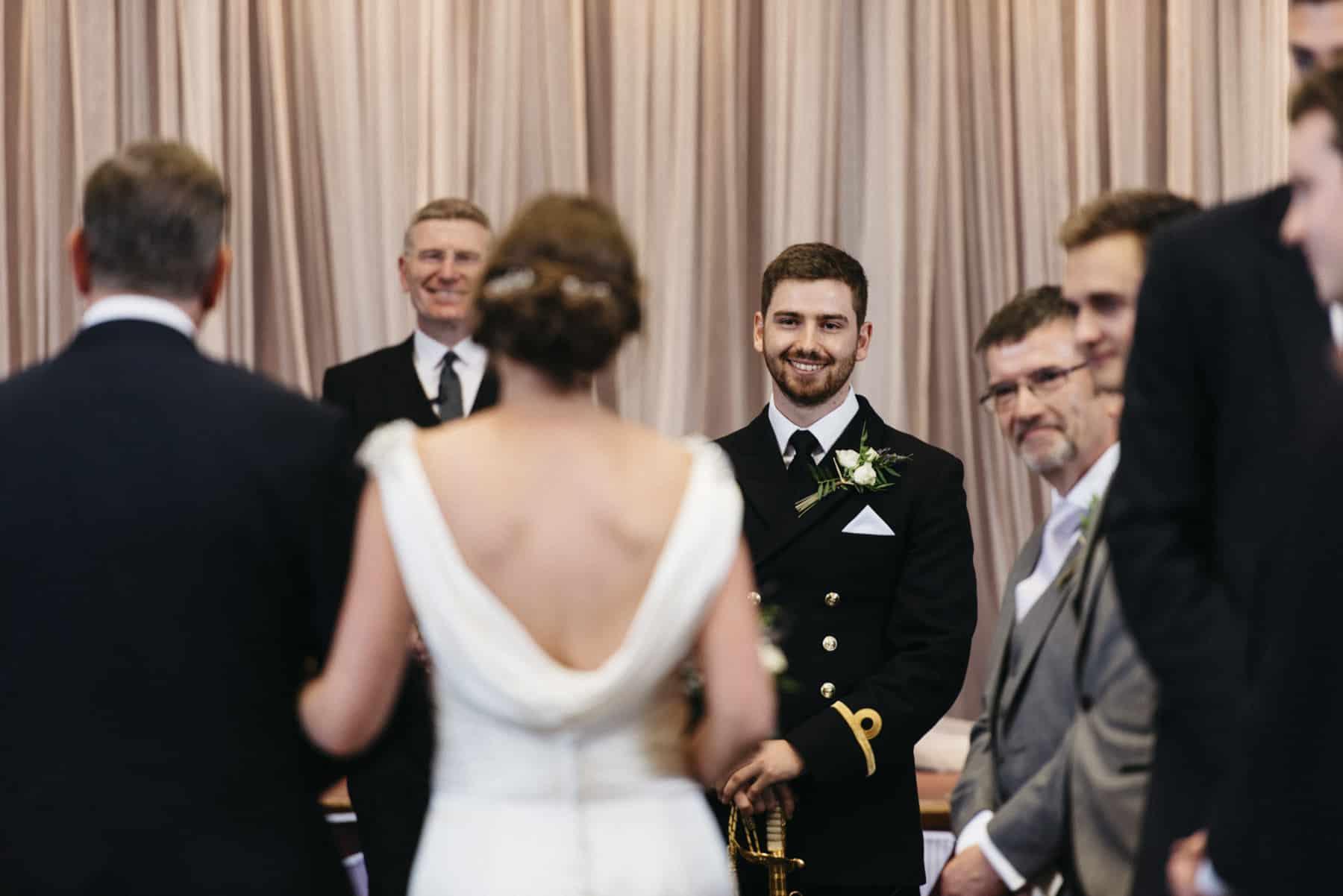 groom sees bride on the aisle