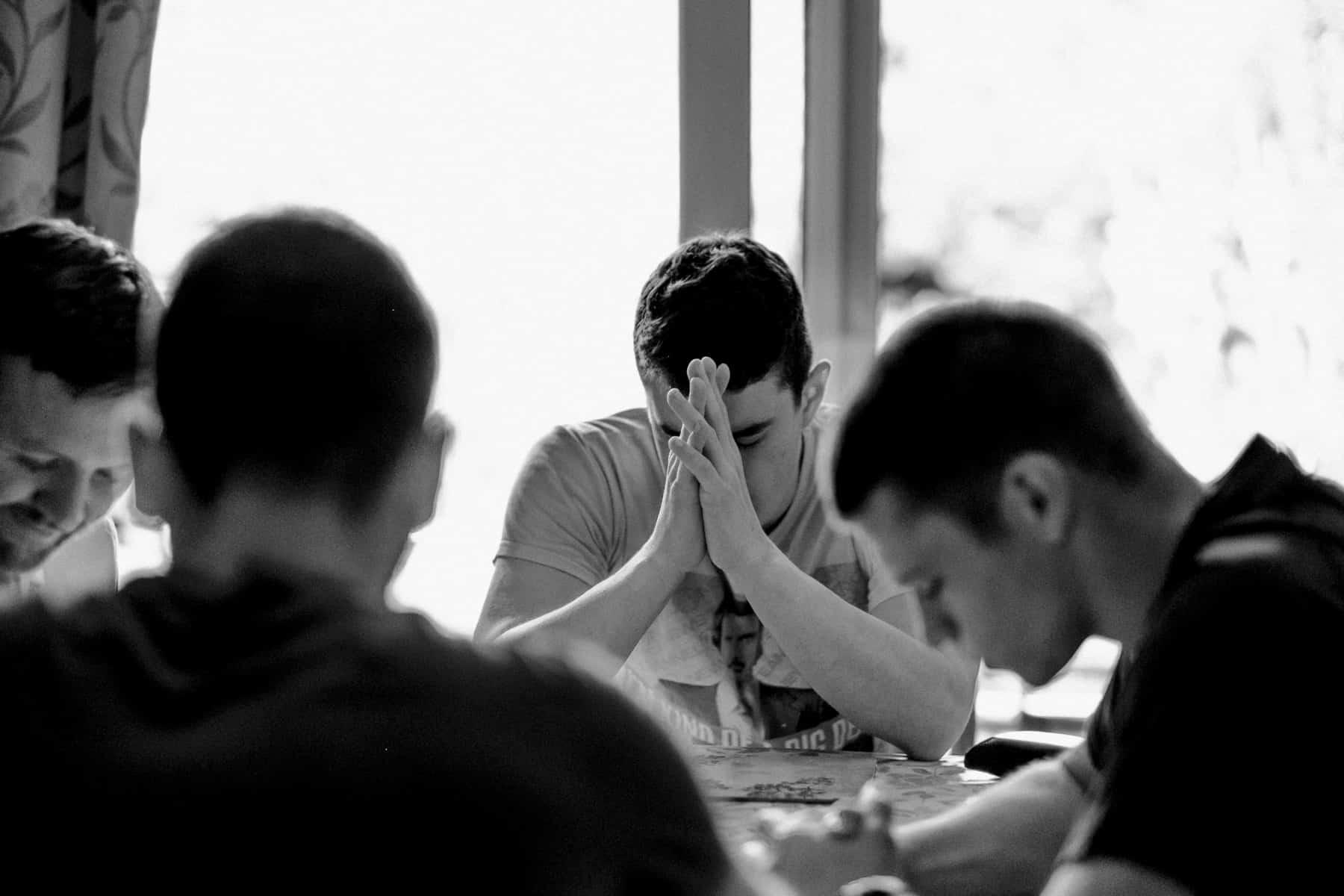 groomsmen pray together