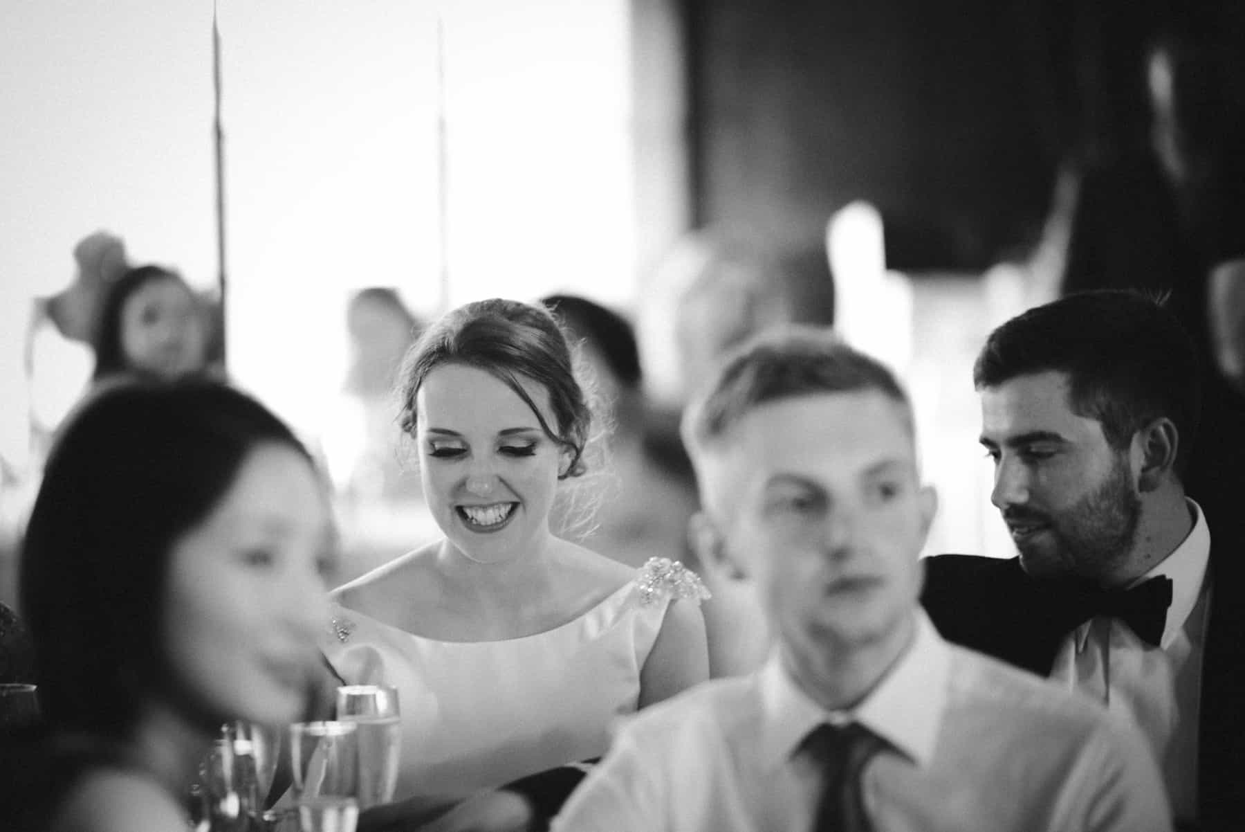 bride enjoying the speeches