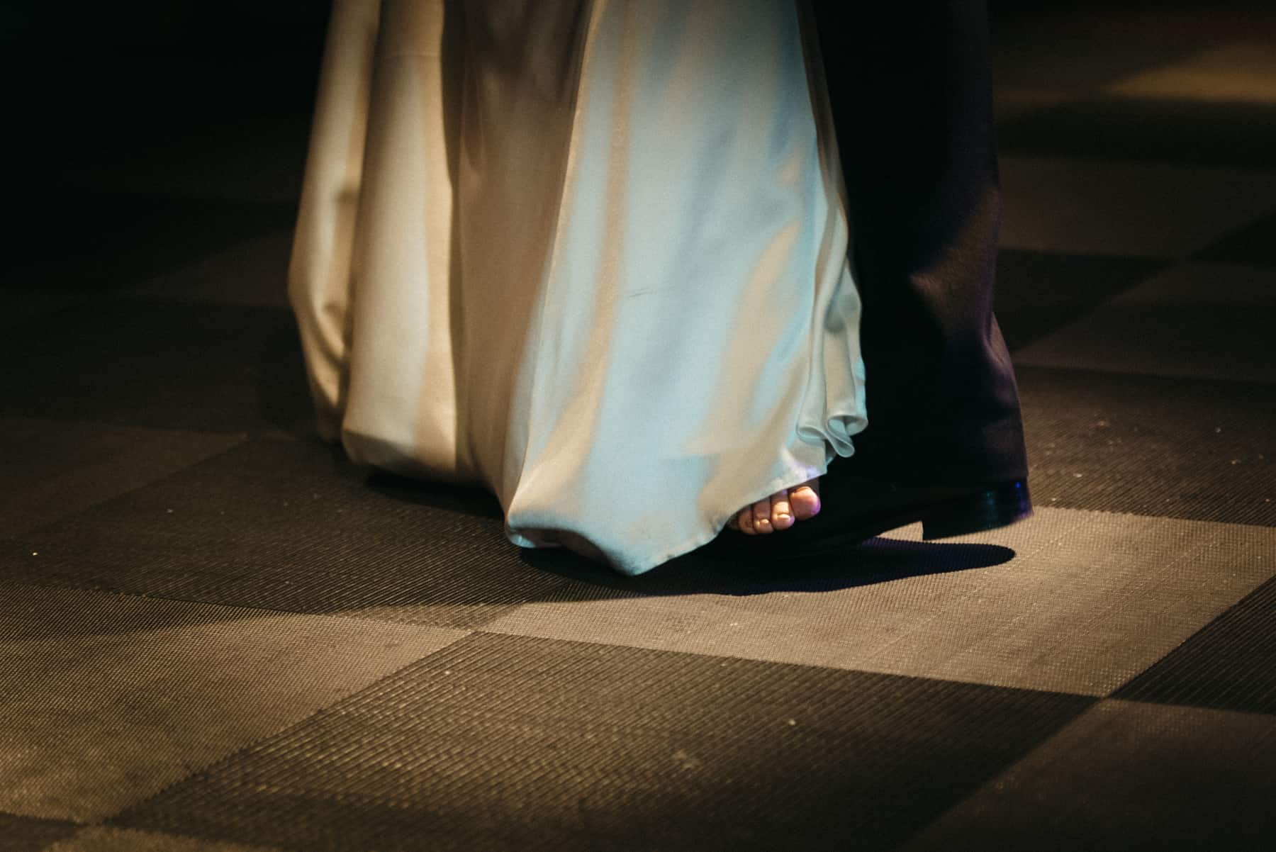 bride dancing on the grooms feet