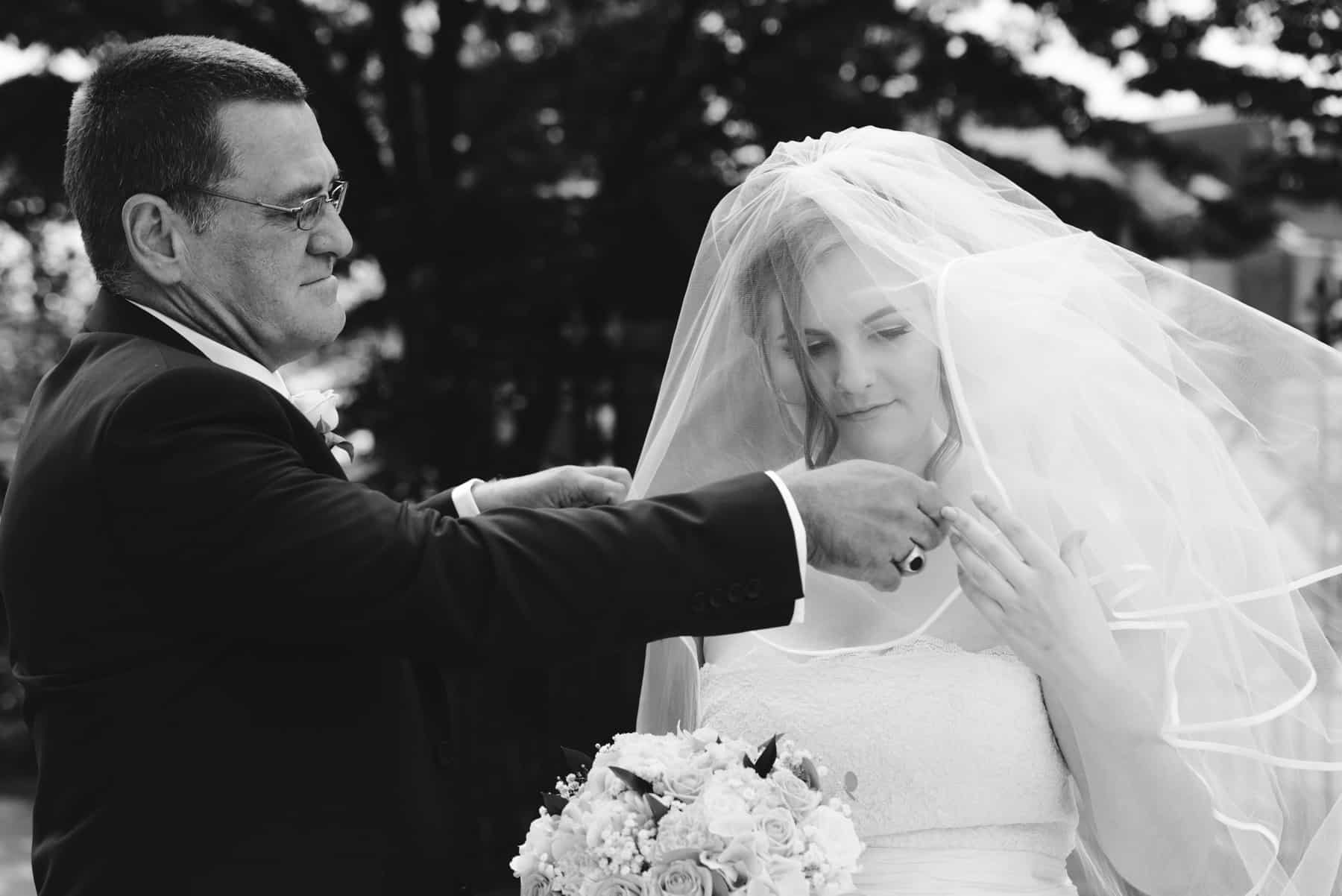 bride's dad lowers her veil