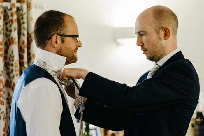 Groomsmen struggle with the ties