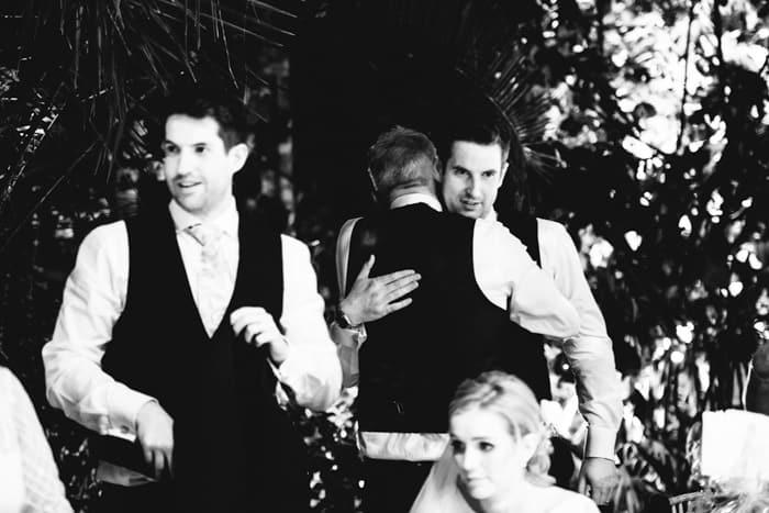 groom and his brother hug