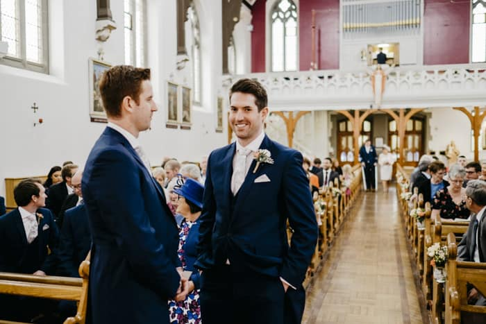broom and best man waiting at the altar