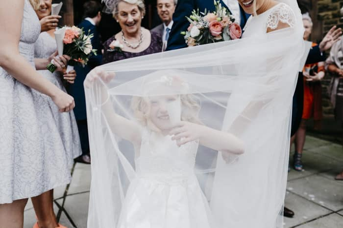 flower girl under the bride's veil
