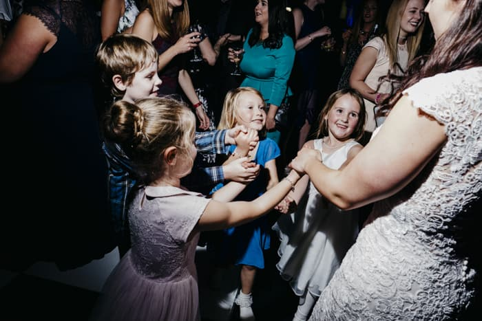kids dancing with the bride
