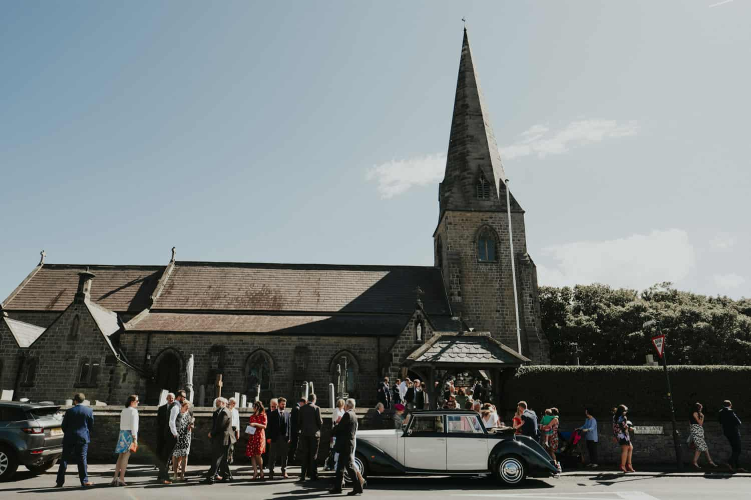 The guests outside the church