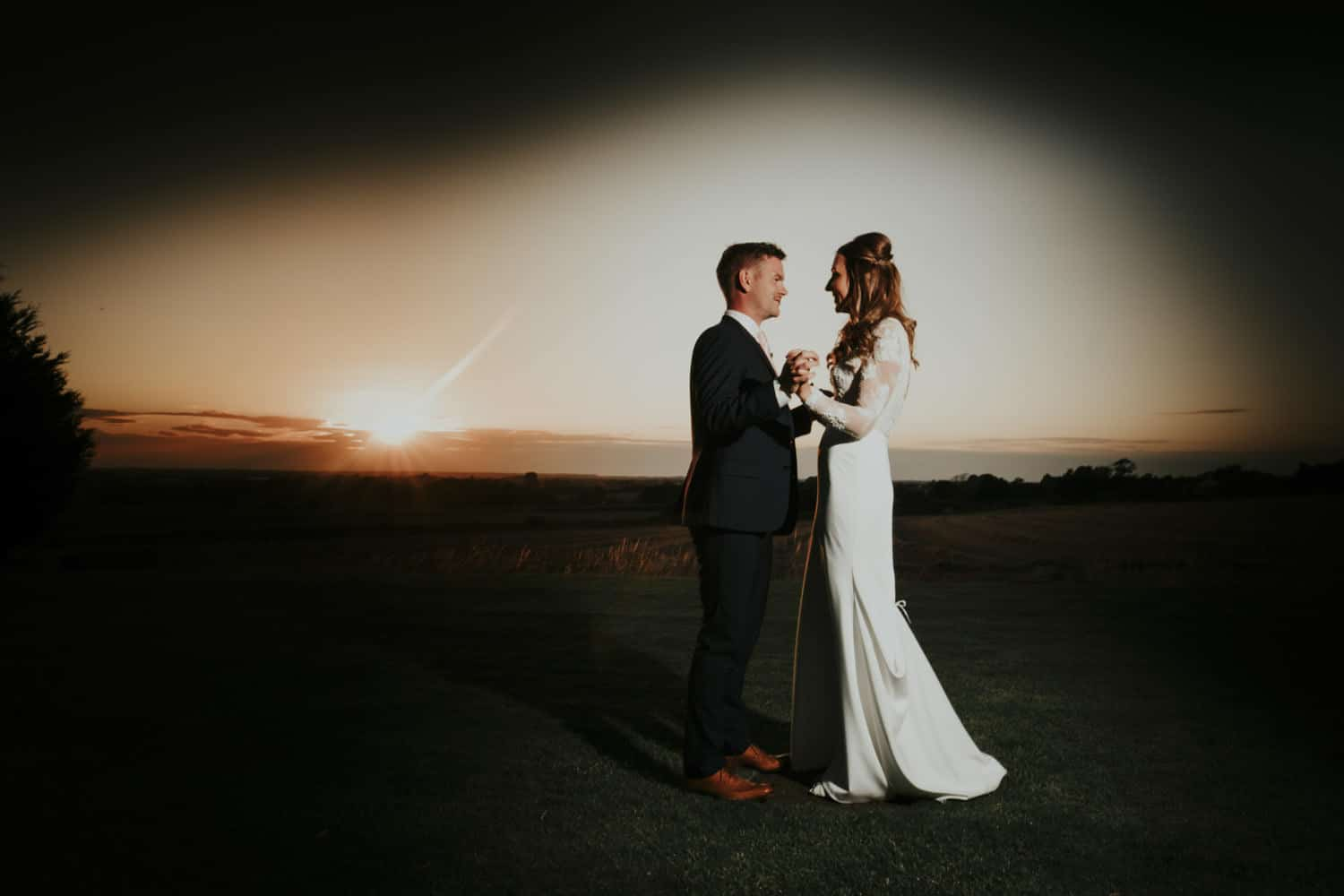 Beautiful sunset portrait of bride and groom
