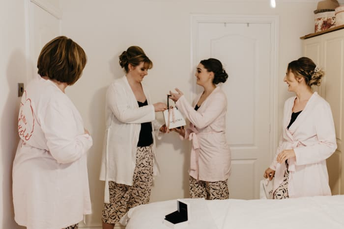 bride gives gifts to bridesmaids