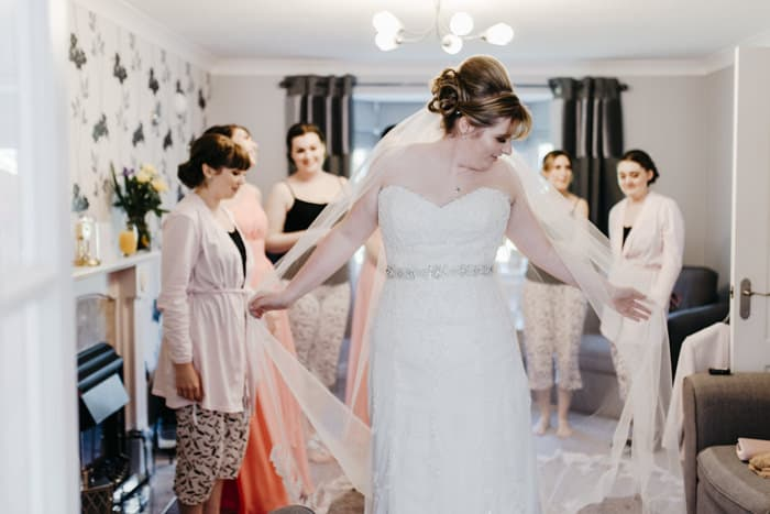 bride shows off her wedding dress