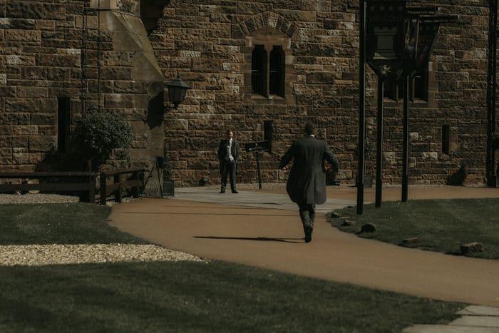 groom walks to meet registrar
