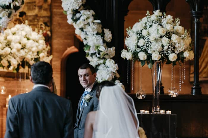 Groom sees his bride in the aisle