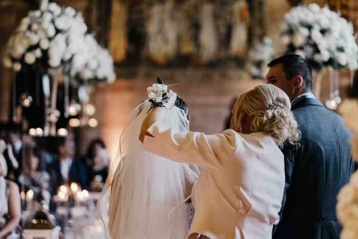 bride's mum fixes the veil