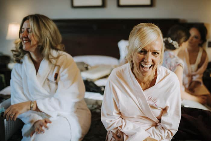mum of bride and bridesmaid share a laugh