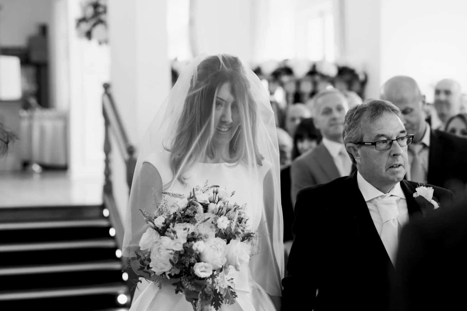 bride and her dad in the aisle