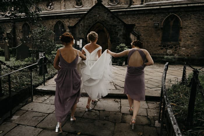 bride and bridesmaid go up the path