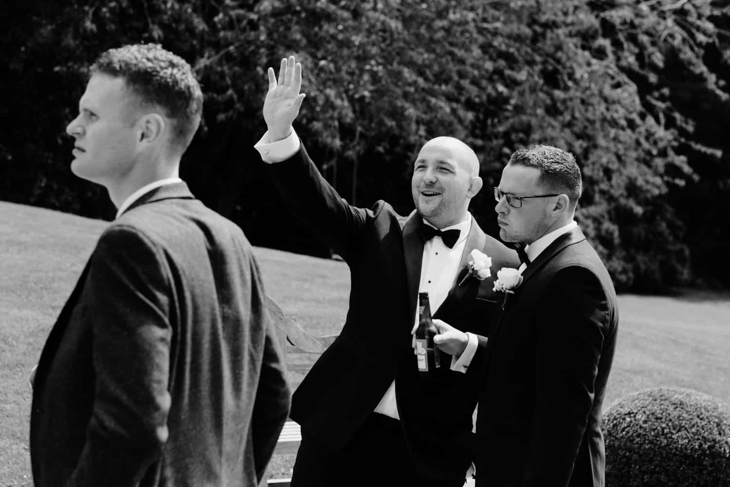 groom waves to guests
