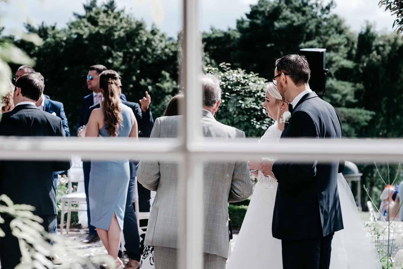 wedding guests enjoy the sun