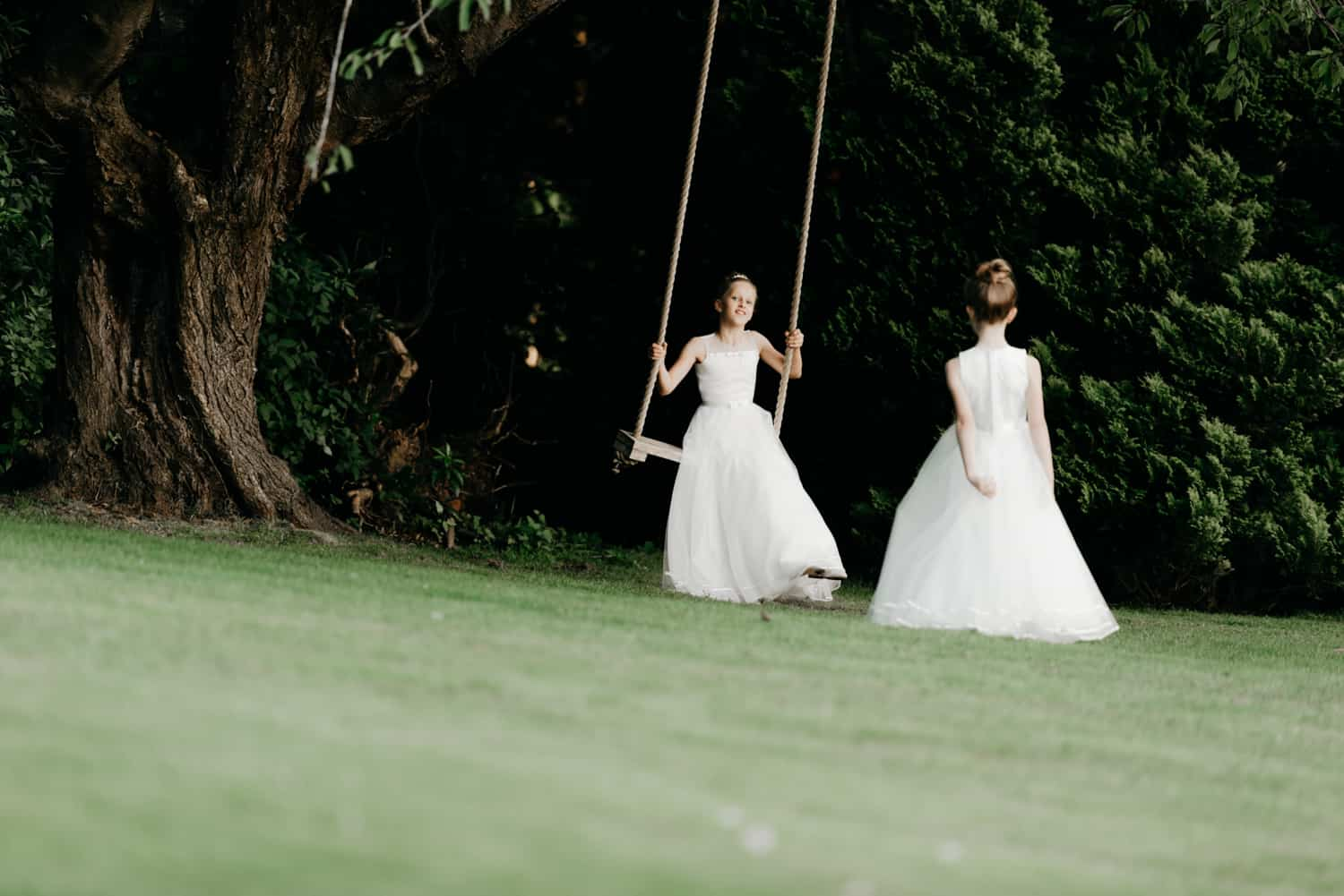 Flower girls on swing