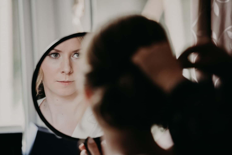 bride checks her make up