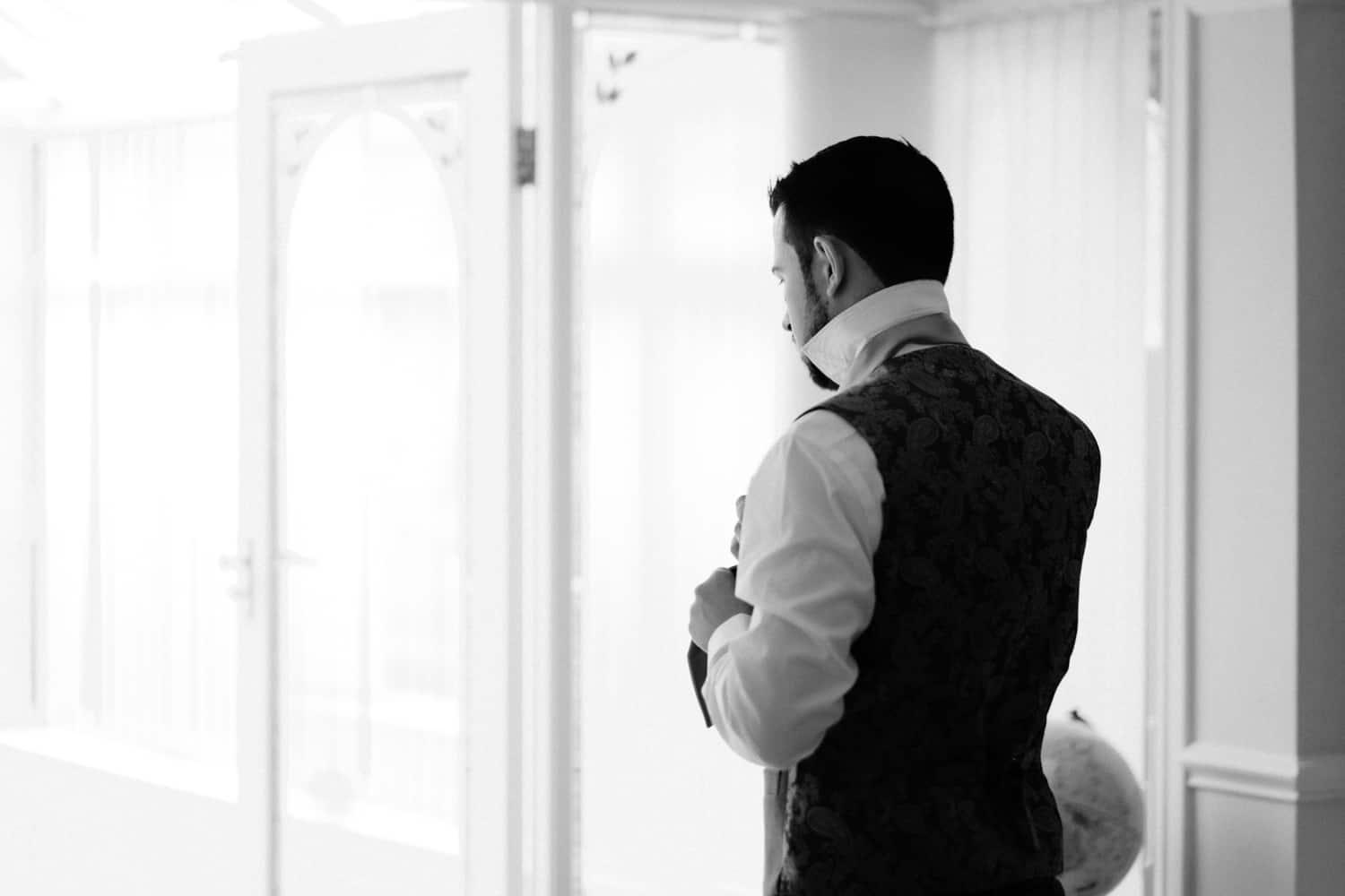 a quiet moment for the groom