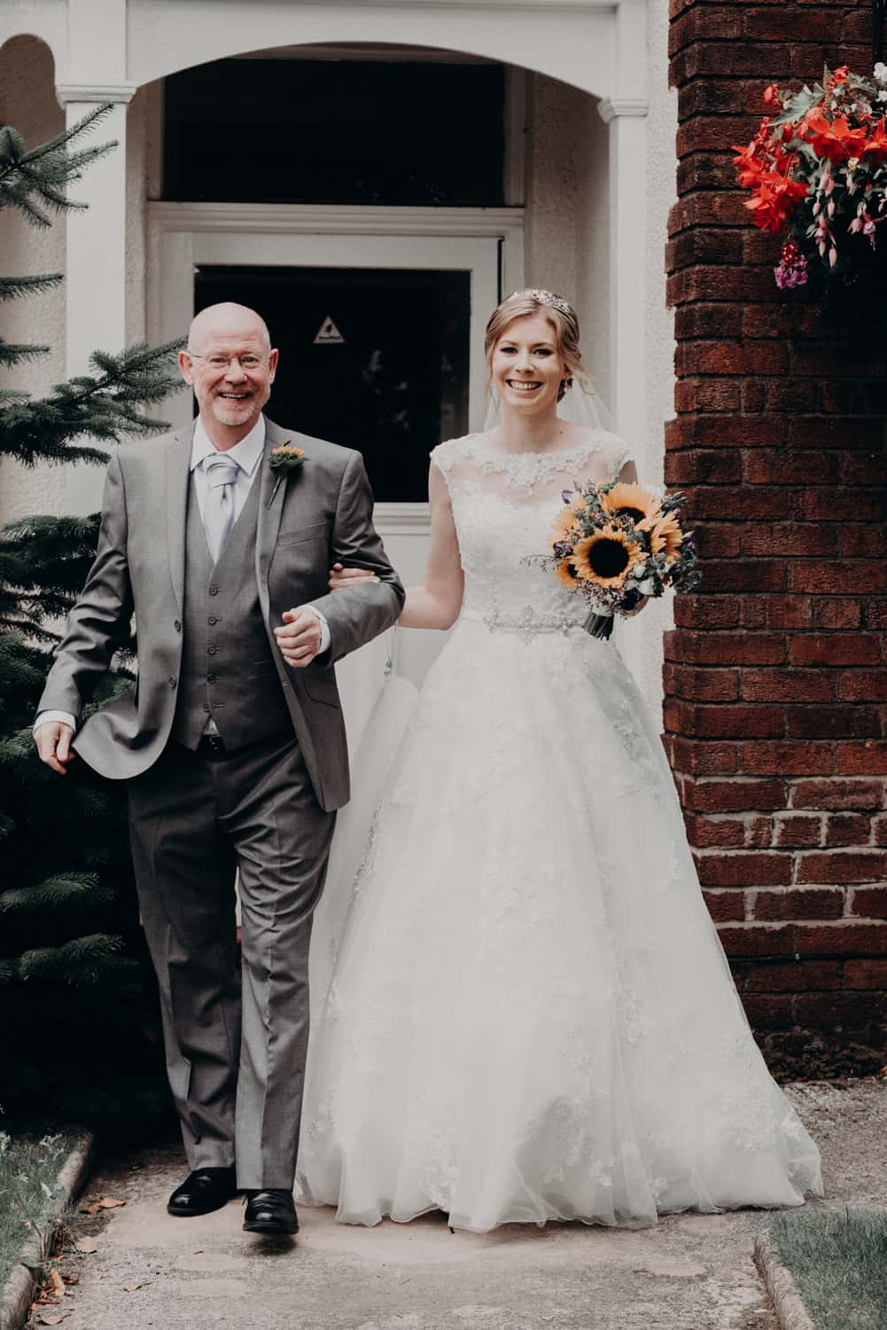 bride and her dad leaving the house