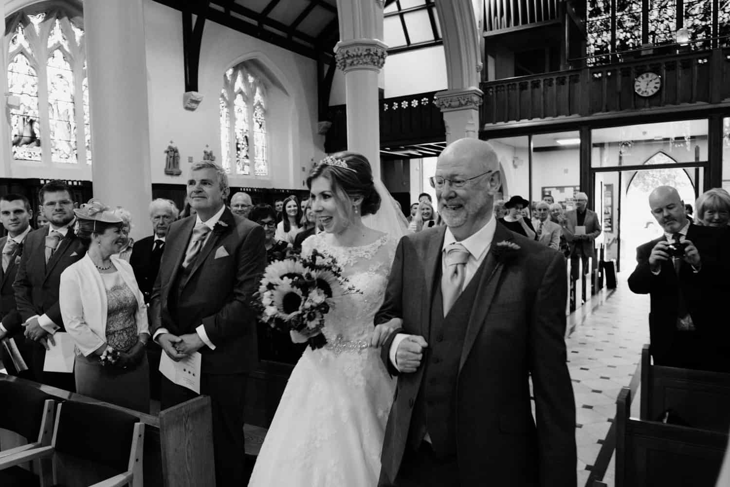 bride and her dad at the altar