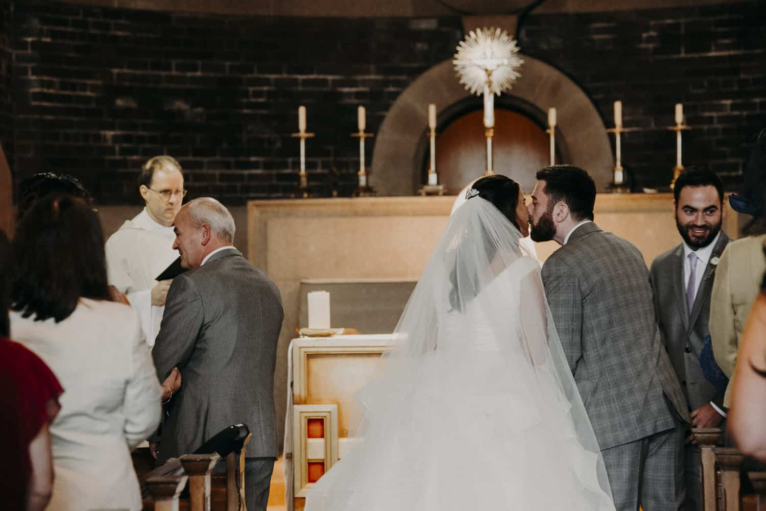 bride and grrom at the altar