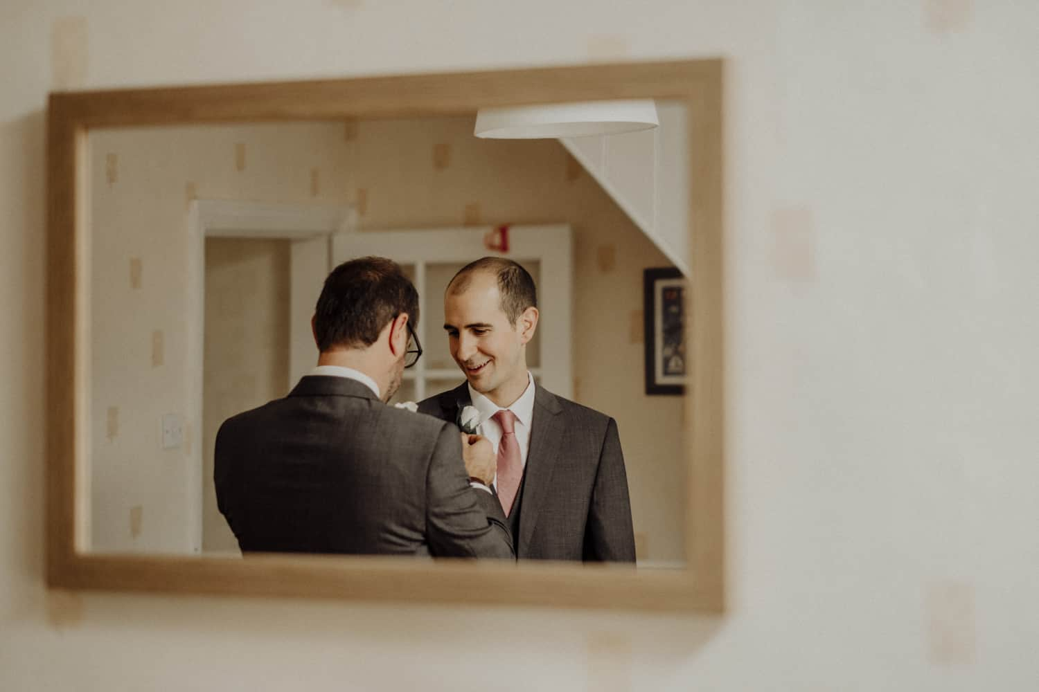 groom and best man in the mirror