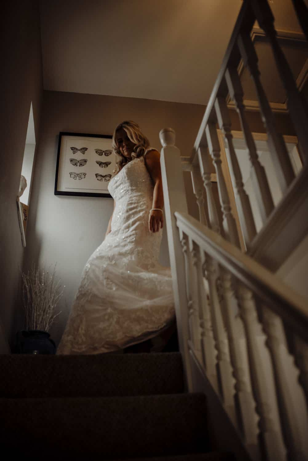 bride comes down the stairs