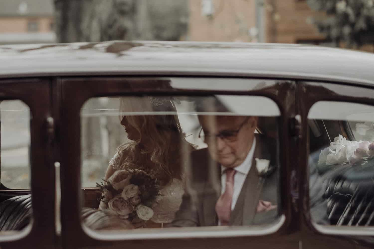 bride and her dad in the car