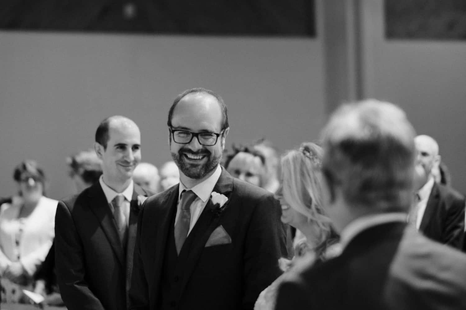 a big smile from the groom