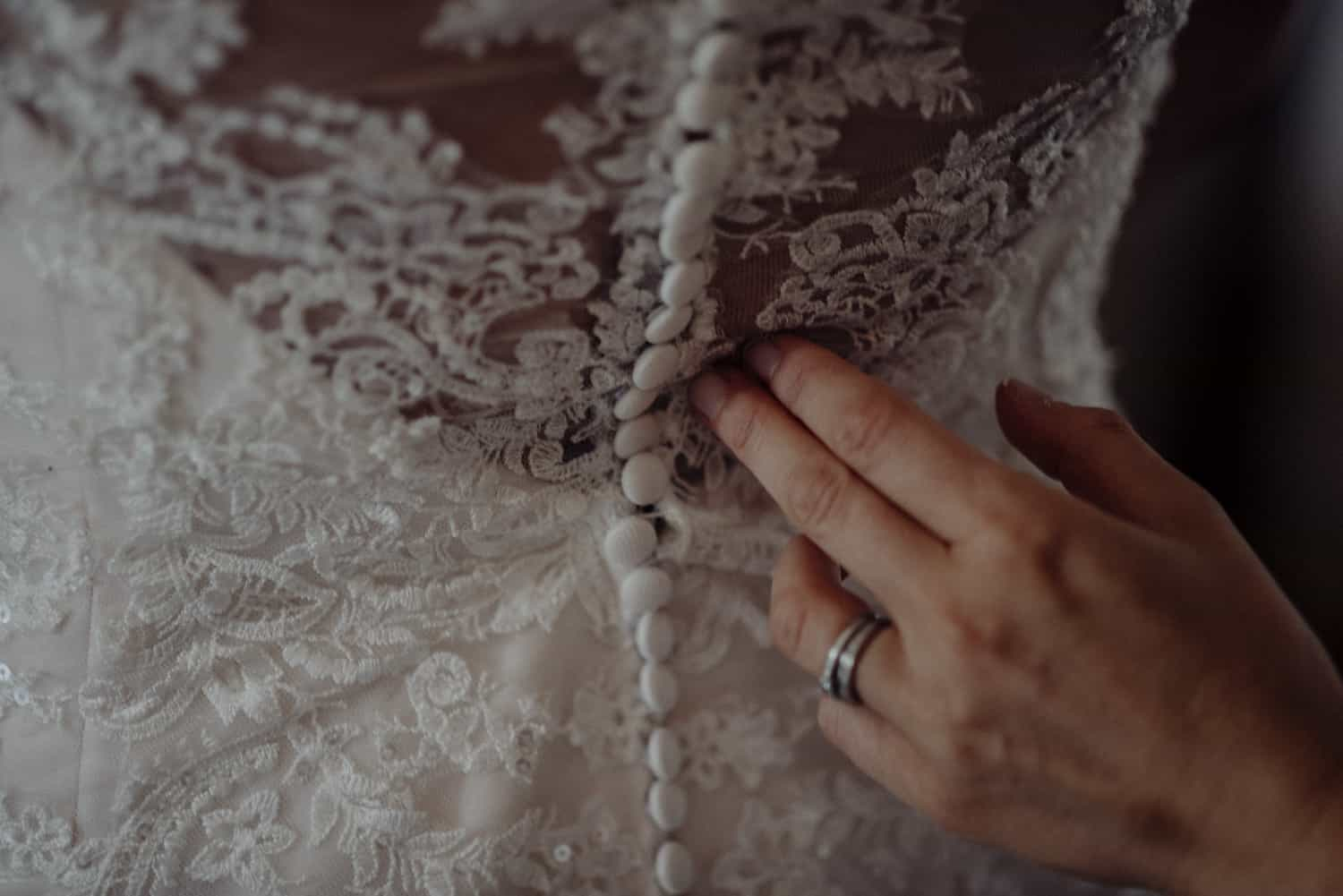 finishing touches to the dress