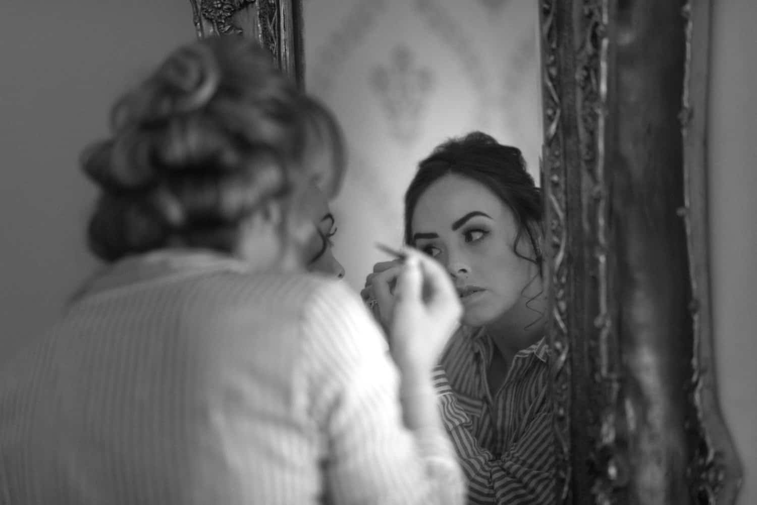 bridesmaid does her make up
