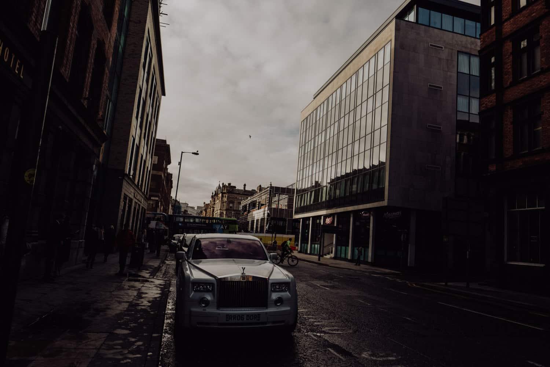 Groomsmen get into the Rolls Royce