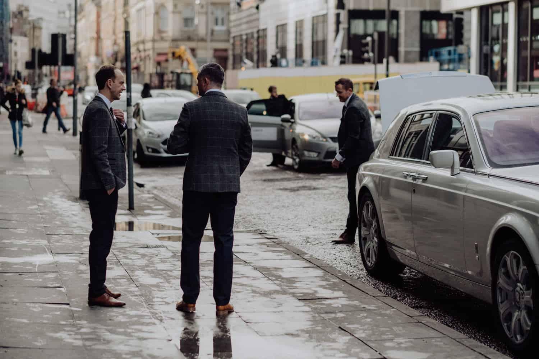 Groomsmen outside the hotel