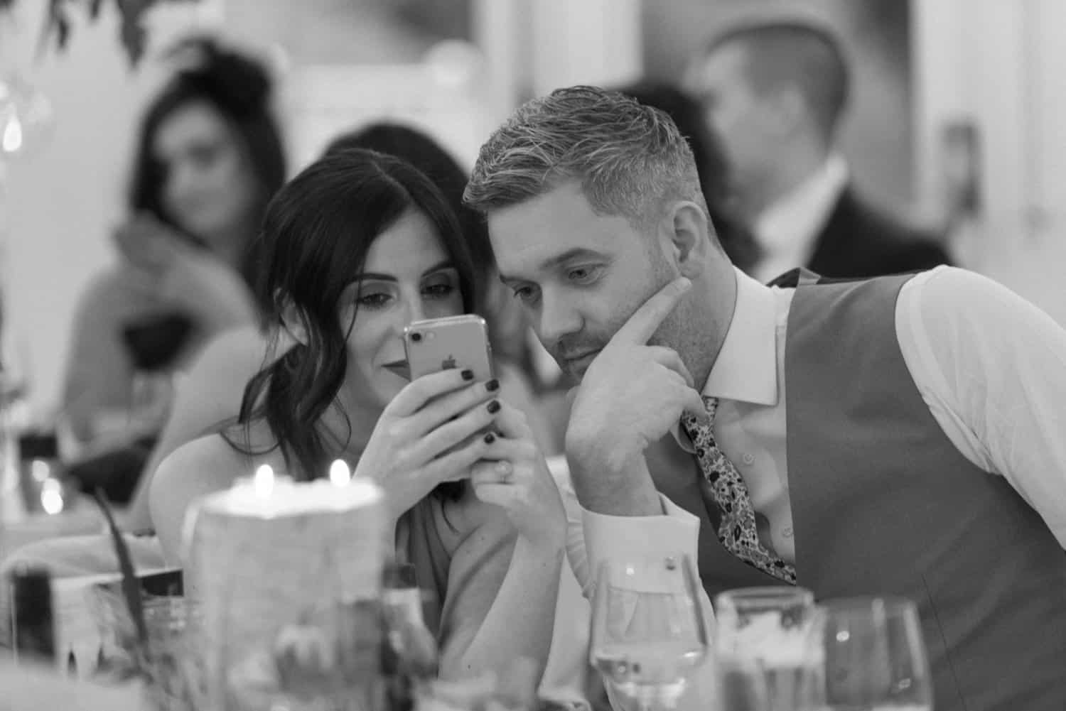 wedding guests on the phone