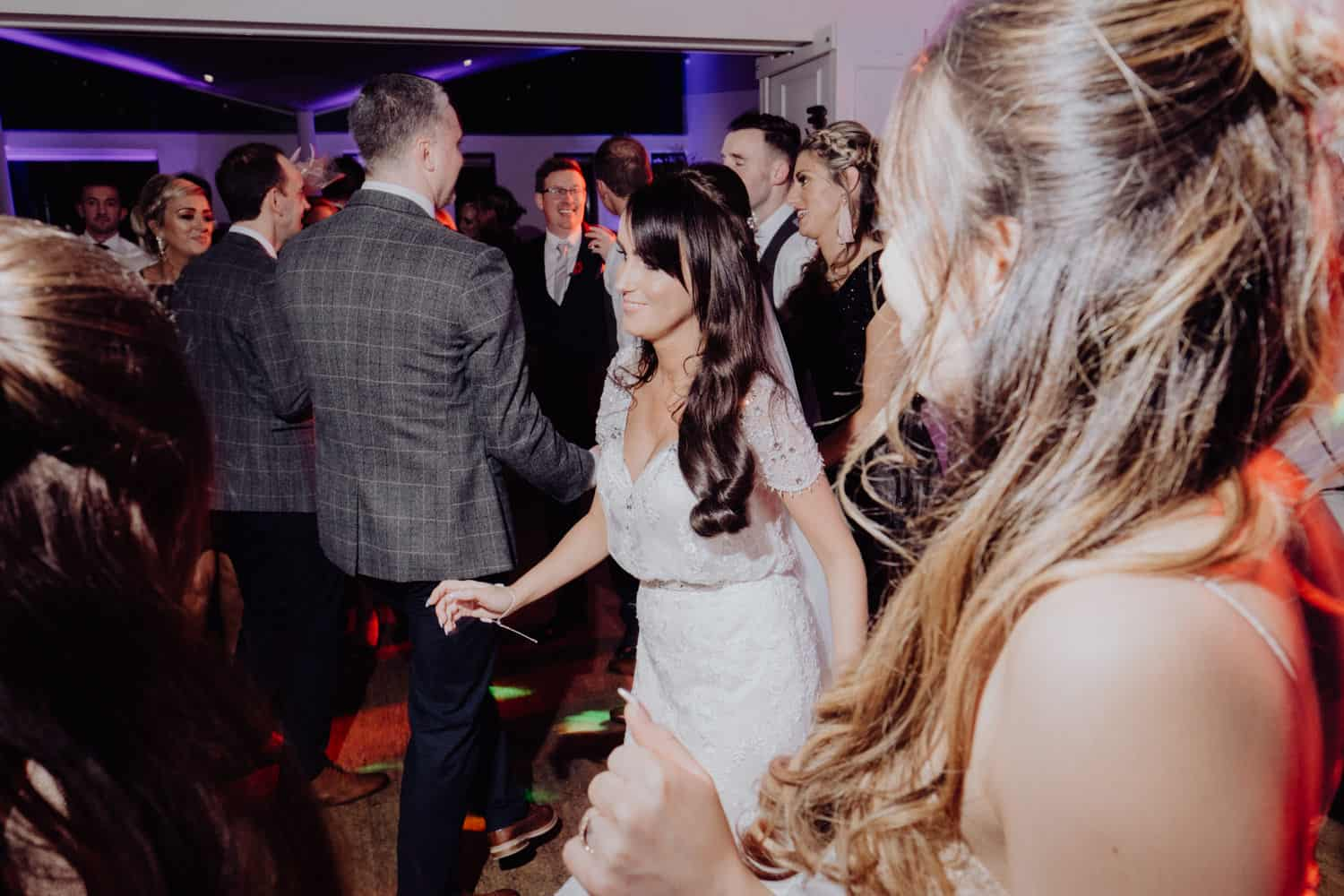 bride and her friends on the dance floor